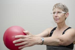 Sally instructing Flexibility stretch w ball